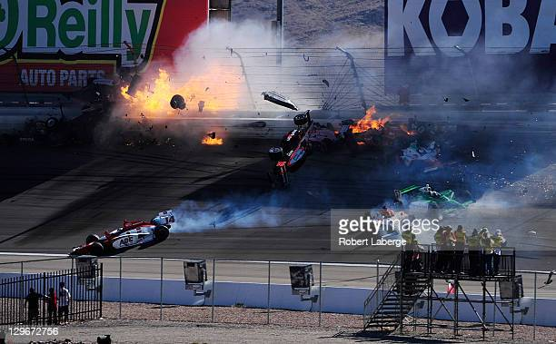 Image 34 in a sequence of 47 images of the crash in which Dan Wheldon of England driver of the Bowers Wilkins Sam Schmidt Motorsports Dallara Honda...