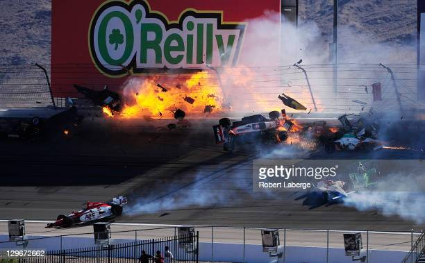 Image 36 in a sequence of 47 images of the crash in which Dan Wheldon of England driver of the Bowers Wilkins Sam Schmidt Motorsports Dallara Honda...