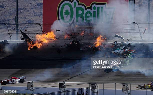 Image 38 in a sequence of 47 images of the crash in which Dan Wheldon of England driver of the Bowers Wilkins Sam Schmidt Motorsports Dallara Honda...