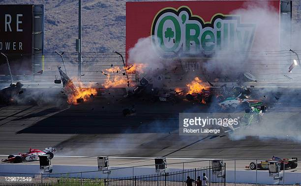 Image 39 in a sequence of 47 images of the crash in which Dan Wheldon of England driver of the Bowers Wilkins Sam Schmidt Motorsports Dallara Honda...