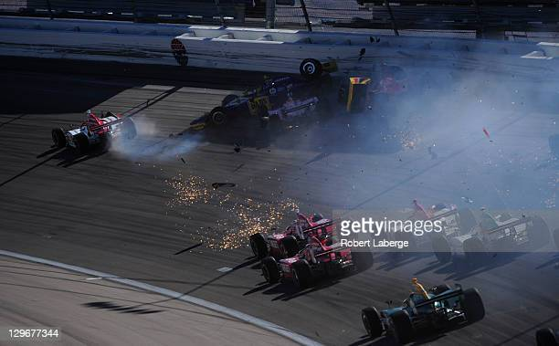 Image 4 in a sequence of 47 images of the crash in which Dan Wheldon of England driver of the Bowers Wilkins Sam Schmidt Motorsports Dallara Honda...