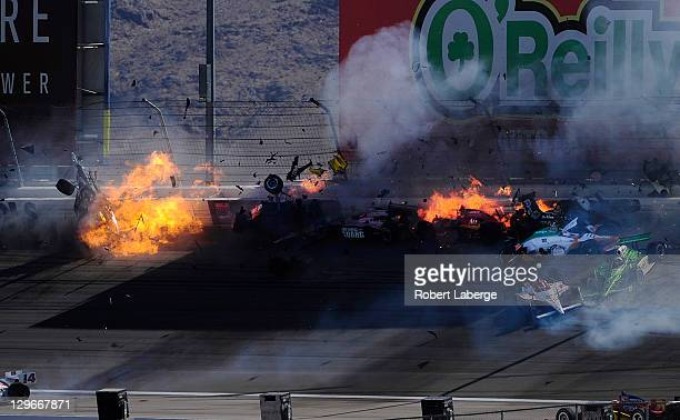 Image 40 in a sequence of 47 images of the crash in which Dan Wheldon of England driver of the Bowers Wilkins Sam Schmidt Motorsports Dallara Honda...