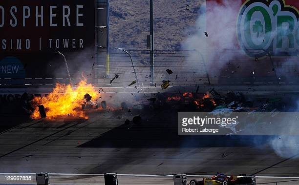 Image 42 in a sequence of 47 images of the crash in which Dan Wheldon of England driver of the Bowers Wilkins Sam Schmidt Motorsports Dallara Honda...