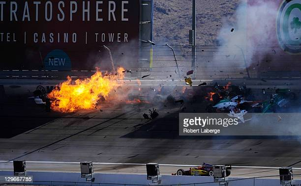 Image 43 in a sequence of 47 images of the crash in which Dan Wheldon of England driver of the Bowers Wilkins Sam Schmidt Motorsports Dallara Honda...