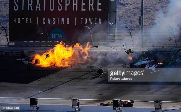 Image 44 in a sequence of 47 images of the crash in which Dan Wheldon of England driver of the Bowers Wilkins Sam Schmidt Motorsports Dallara Honda...