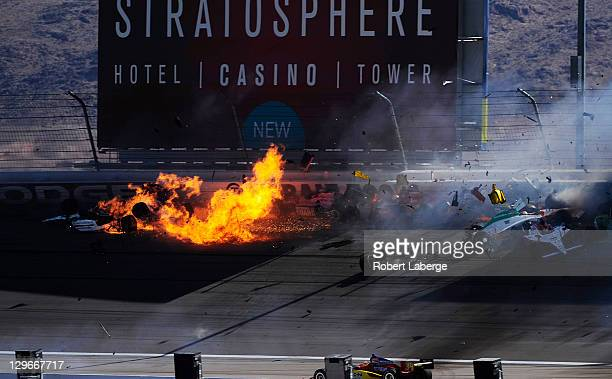 Image 45 in a sequence of 47 images of the crash in which Dan Wheldon of England driver of the Bowers Wilkins Sam Schmidt Motorsports Dallara Honda...
