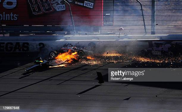 Image 47 in a sequence of 47 images of the crash in which Dan Wheldon of England driver of the Bowers Wilkins Sam Schmidt Motorsports Dallara Honda...