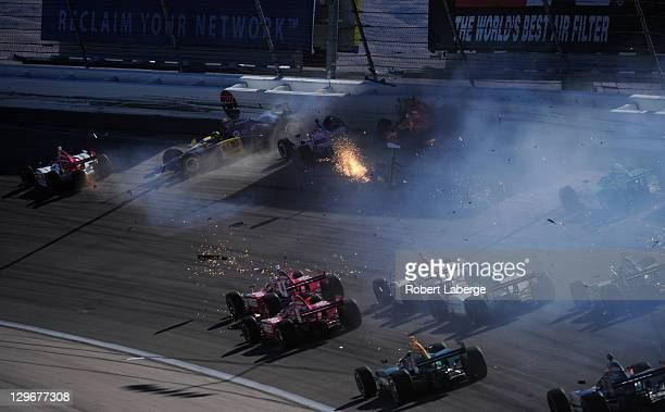 Image 5 in a sequence of 47 images of the crash in which Dan Wheldon of England driver of the Bowers Wilkins Sam Schmidt Motorsports Dallara Honda...