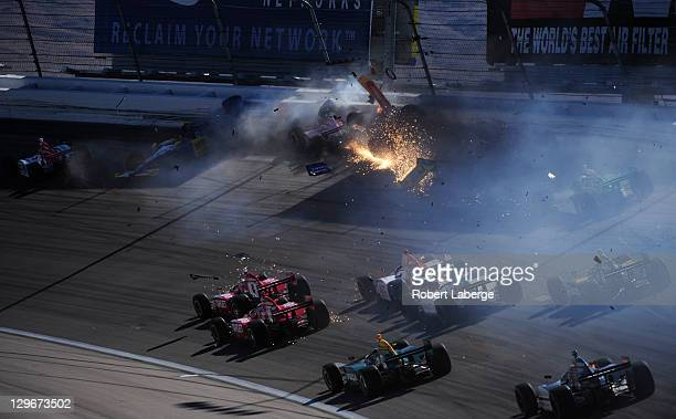 Image 6 in a sequence of 47 images of the crash in which Dan Wheldon of England driver of the Bowers Wilkins Sam Schmidt Motorsports Dallara Honda...