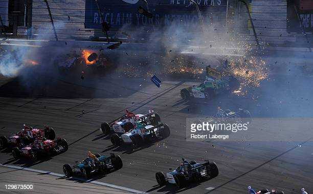 Image 7 in a sequence of 47 images of the crash in which Dan Wheldon of England driver of the Bowers Wilkins Sam Schmidt Motorsports Dallara Honda...