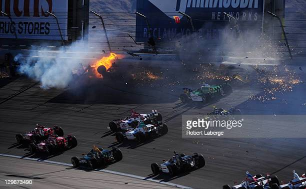 Image 8 in a sequence of 47 images of the crash in which Dan Wheldon of England driver of the Bowers Wilkins Sam Schmidt Motorsports Dallara Honda...