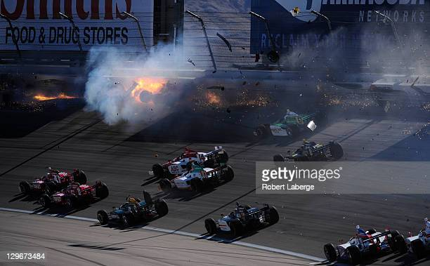 Image 9 in a sequence of 47 images of the crash in which Dan Wheldon of England driver of the Bowers Wilkins Sam Schmidt Motorsports Dallara Honda...