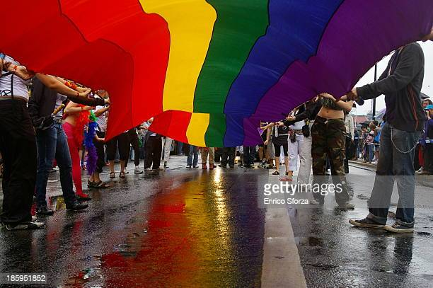 Image captured at Stockholm Euro Pride 2008 under a very long peace flag