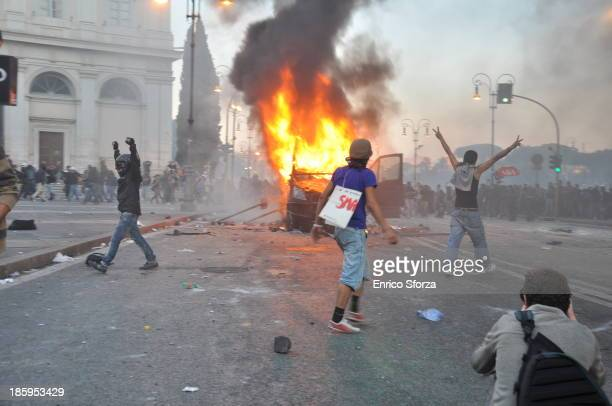 """Image captured in Piazza S.Giovanni, Rome, during the fights inside """"INDIGNADOS"""" demonstretion in Piazza S.Giovanni, Rome. Three guys celebrate after..."""