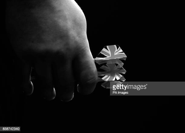 *Image changed to black and white in Photoshop* James Wade holds his darts during the Ladbrokescom World Darts Championship at Alexandra Palace London
