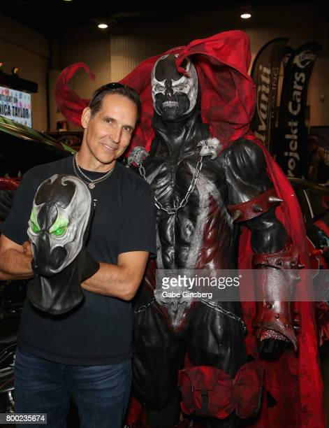Image Comics Cofounder Todd McFarlane and Tom Proprofsky dressed as the character Spawn from the 'Spawn' comic book series attend the Amazing Las...