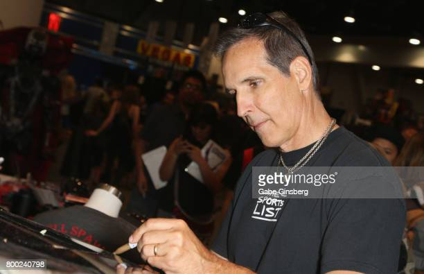Image Comics cofounder Todd McFarlane signs autographs during the Amazing Las Vegas Comic Con at the Las Vegas Convention Center on June 23 2017 in...