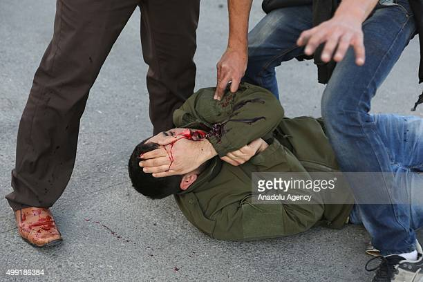 Image contains graphic content] A Palestinian protester wounded by Israeli Security forces' attack lays on the during a demonstration against Israeli...