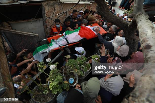 Image depicts death] Palestinians carry the dead body of Mohammed Hamayel died after Israeli forces' intervention in a demonstration during his...
