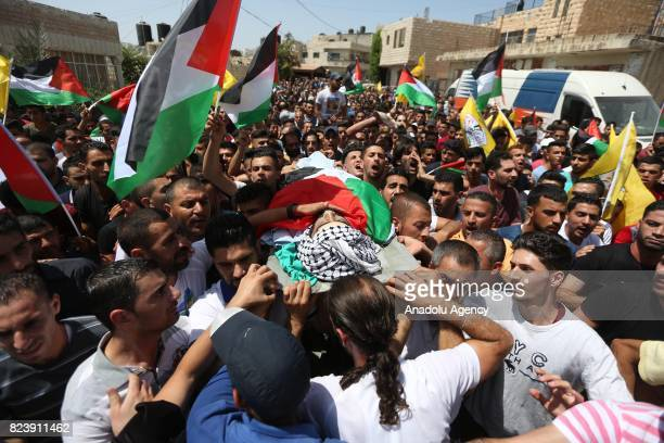 Image depicts death] Palestinians carry the dead body of Muhammad Fathi Kanaan who was killed by Israeli security forces during a demonstration...