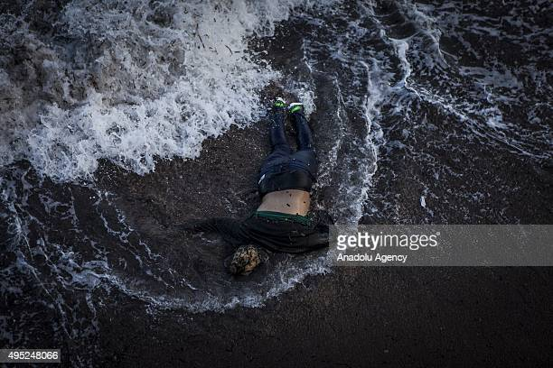 Image depicts death] The body of a refugee is washed ashore on a beach after a boat carrying refugees sank off the coast of Greece's Lesbos Island on...