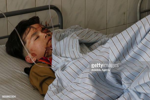 Image depicts graphic content] A wounded Afghan child receives medical treatment at a local hospital after a suicide bomb blast that targeted a...