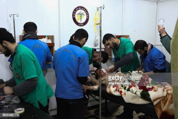 Image depicts graphic content] A wounded child gets treatment at a sahra hospital after an airstrike carried out by the warplanes of Assad Regime in...
