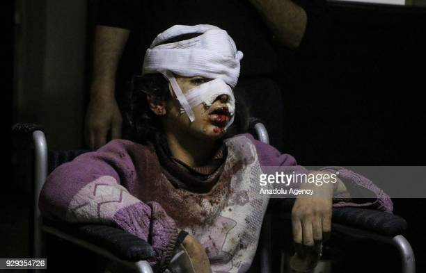 Image depicts graphic content] A wounded child on a wheelchair is seen at a field hospital after Assad Regime's attacks over Zamalka suburb of the...