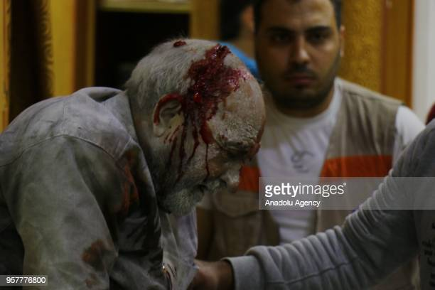 Image depicts graphic content] An injured man receives treatment at a hospital after a bomb laden car explodes in front of the district hospital near...