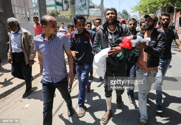Image depicts graphic content] Palestinian mourners carry the body of eightmonthold Palestinian baby Leila Anwar Ghandoour died from tear gas...