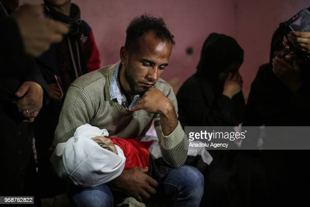 Image depicts graphic content] Palestinians mourn over the body of eightmonthold Palestinian baby Leila Anwar Ghandoour died from tear gas inhalation...