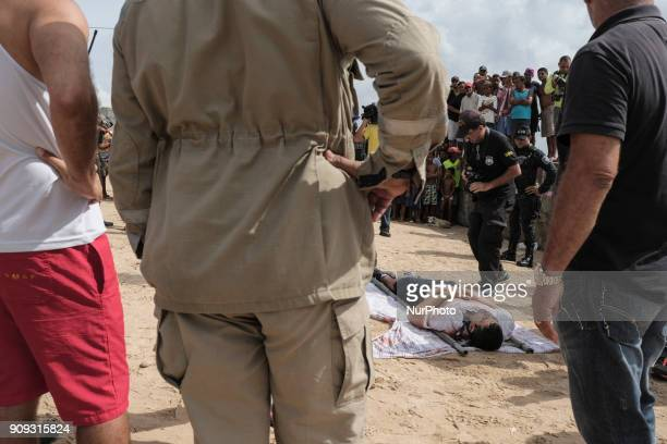 Image depicts graphic content] The body of the pilot Daniel Galvão who was rescued without life by the residents is taken to the Medical Legal...