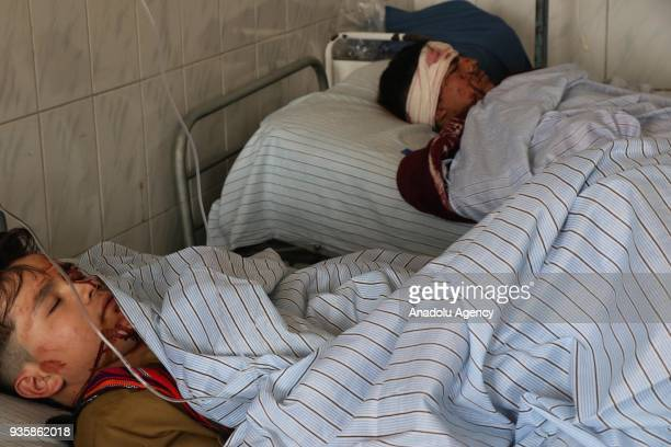 Image depicts graphic content] Wounded Afghan children receive medical treatments at a local hospital after a suicide bomb blast that targeted a...