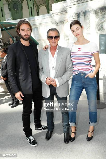 Image Director at Chanel Eric Pfrunder standing between his son Jasper Pfrunder and model Ophelie Guillermand attend the Chanel Haute Couture Fall...