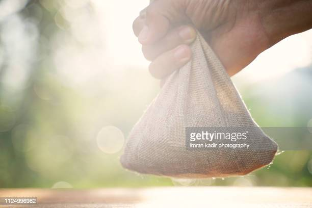 image for take the coins in the sack - treasuregold stock pictures, royalty-free photos & images