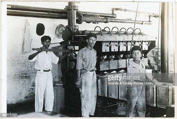 Image from the S Pearson Son Collection of the Tampico case and can factory in Mexico Photograph of workers filling the cans March 1920