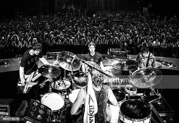 Image has been converted to black and white.) 5 Seconds of Summer performs onstage during Vevo Certified Live at Barker Hangar on August 17, 2015 in...