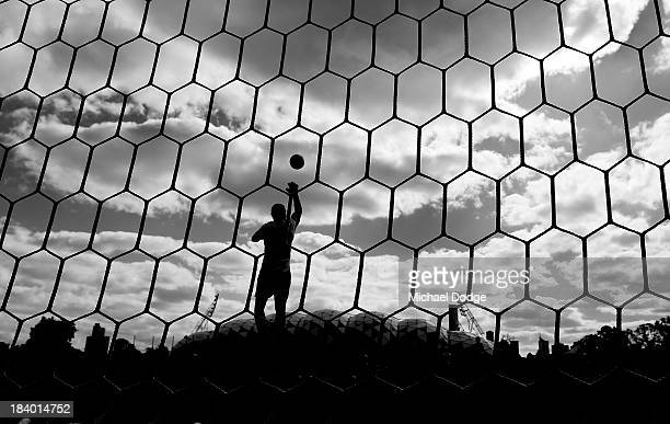 Image has been converted to black and white.) Goal keeper Ashley McGrath stops the ball during an Indigenous Australian International Rules Team...