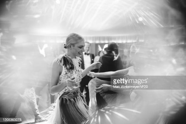 Image has been created in camera using a reflective surface and edited using digital filters Hunter Schafer attends the 2020 Vanity Fair Oscar Party...