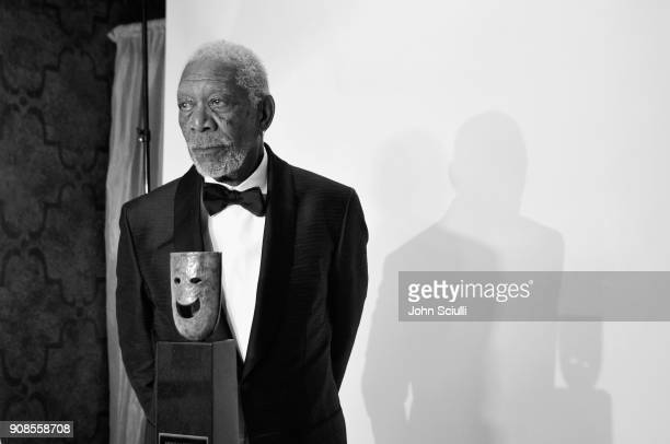 EDITORS NOTE Image has been shot in black and white Color version not available Actor Morgan Freeman poses in the trophy room at the 24th Annual...