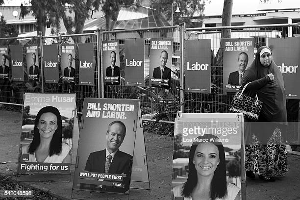 Image has been shot in black and white no colour version available A woman walks past Labor signage as she arrives at the Australian Labor Party 2016...