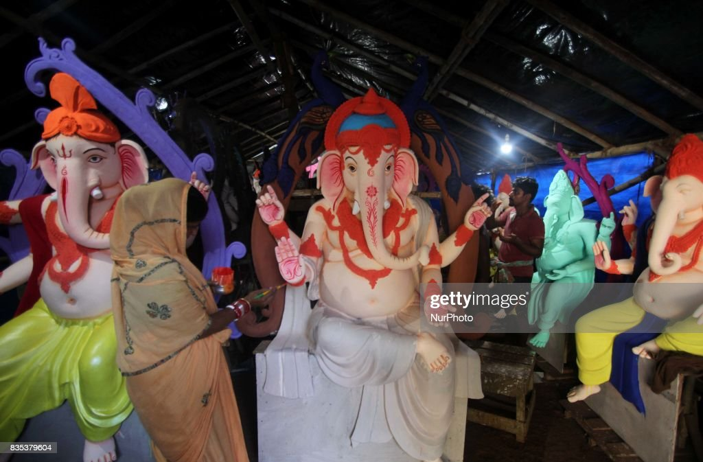 Image makers busy to apply colors into the clay images of elephant headed God Ganesha ahead of the Ganesha Chatruthi festival at a village outskirts of the eastern Indian state Odisha's capital city Bhubaneswar on 19 August 2017.