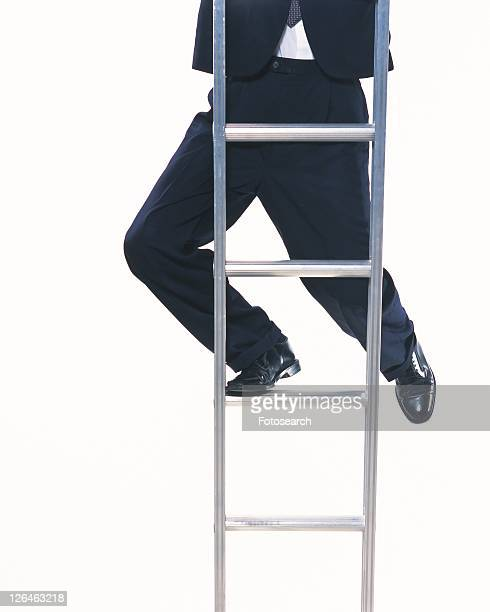 Image of a Businessman Climbing Up a Metallic Ladder, Front View