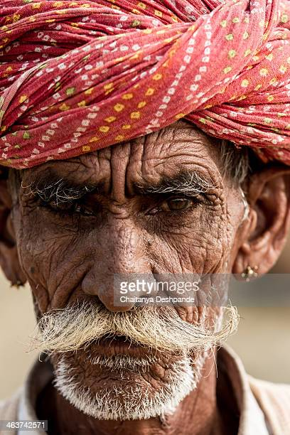CONTENT] Image of a camel herdsman in Pushkar Rajasthan India during the annual camel fair at Pushkar Camel herders come from villages around Pushkar...