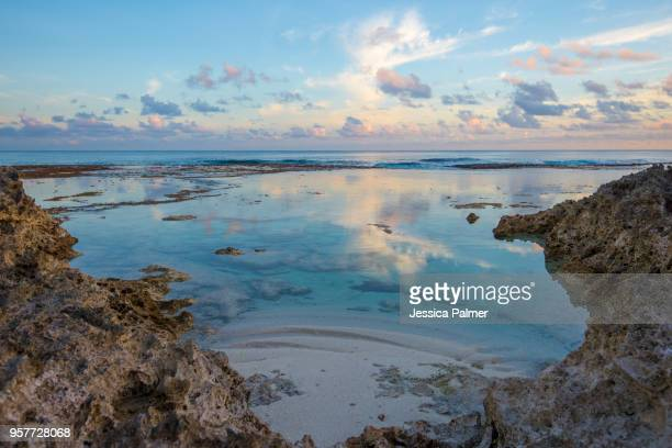 image of a deserted cove at sunset on the island of atiu in the cook islands - isole cook foto e immagini stock