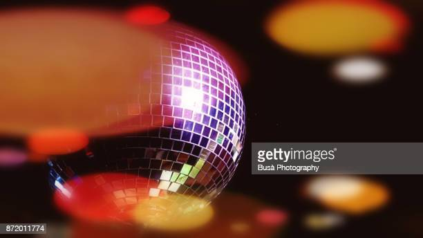image of a disco ball in a nightclub - disco ball fotografías e imágenes de stock