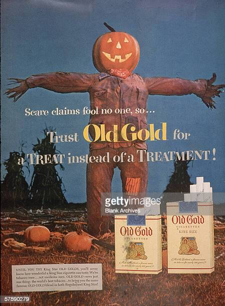 Image of a halloweenthemed magazine ad for Old Gold cigarettes featuring a scarecrow with a jacko'lantern head in a pumpkin patch 1953