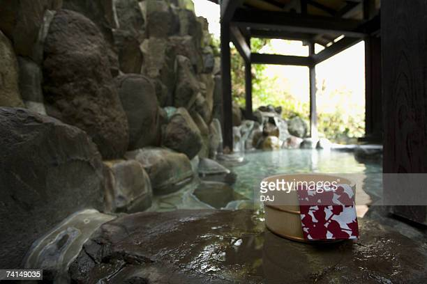 Image of a Japanese Outdoor Hot Spring Bath, Tub and Tenugui at the Side