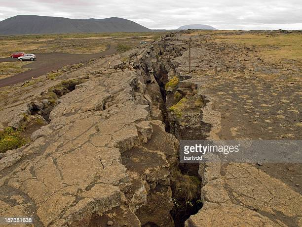 image of a large fissure in the earth - earthquake stock pictures, royalty-free photos & images