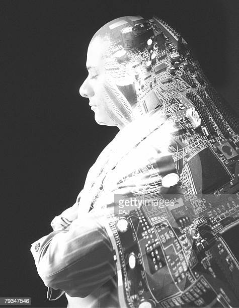 image of a man with his eyes closed, folding his arms, with a distorted image of a pcb on his back, side view, cg - digital distortion stock photos and pictures
